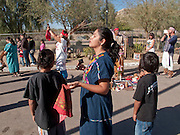 Jan 31, 2009 -- PHOENIX, AZ: Traditional Nahuat (Aztec) dancers perform a blessing at the Macehualli Work Center. The Macehualli Work Center in north Phoenix opened six years as a city of Phoenix supported day labor center. The work center is now privately owned but still supports day laborers who congregate in the area. Many of the center's clients are undocumented immigrants. The presence of the undocumented immigrants has made the center a flashpoint in the illegal immigration debate in Phoenix.  Photo by Jack Kurtz / ZUMA Press