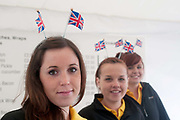 April 29th 2011 Royal Wedding. Trafalgar Square. Marks and Spencers young women at checkout wearing Union Jack antlers.