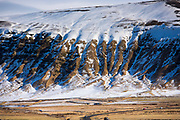 Dramatic snow-covered volcanic mountain in South Iceland