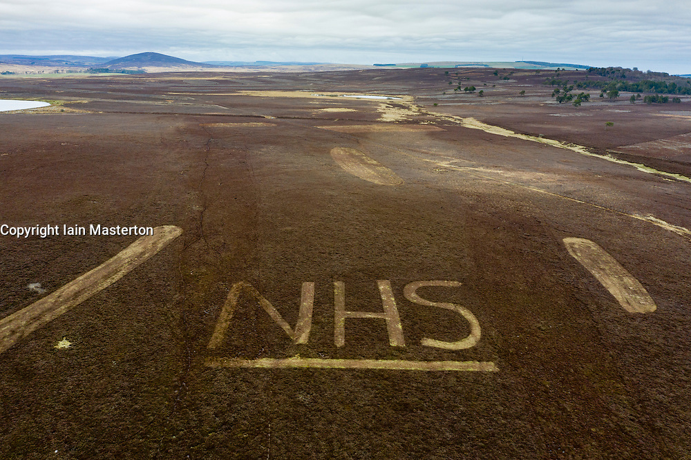 Greenlaw, Scotland, UK. 16 April 2020. Gamekeepers have sculpted the letters NHS in heather on a hillside on Greenlaw Moor in solidarity with NHS workers driving past. They took time out from cutting and mowing areas of heather as part of seasonal fire prevention operations to mow their message of support. Iain Masterton/Alamy Live News