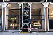 ClosedAsprey shop as wormen put up Christmas decorations on Bond Street as Londoners await the imminent end of the second coronavirus national lockdown before the capital enters tier two in the new three tier system on 1st December 2020 in London, United Kingdom. Non essential shops will be allowed to reopen as of 2nd December while in other areas of the country, controversially, they will have to remain closed.