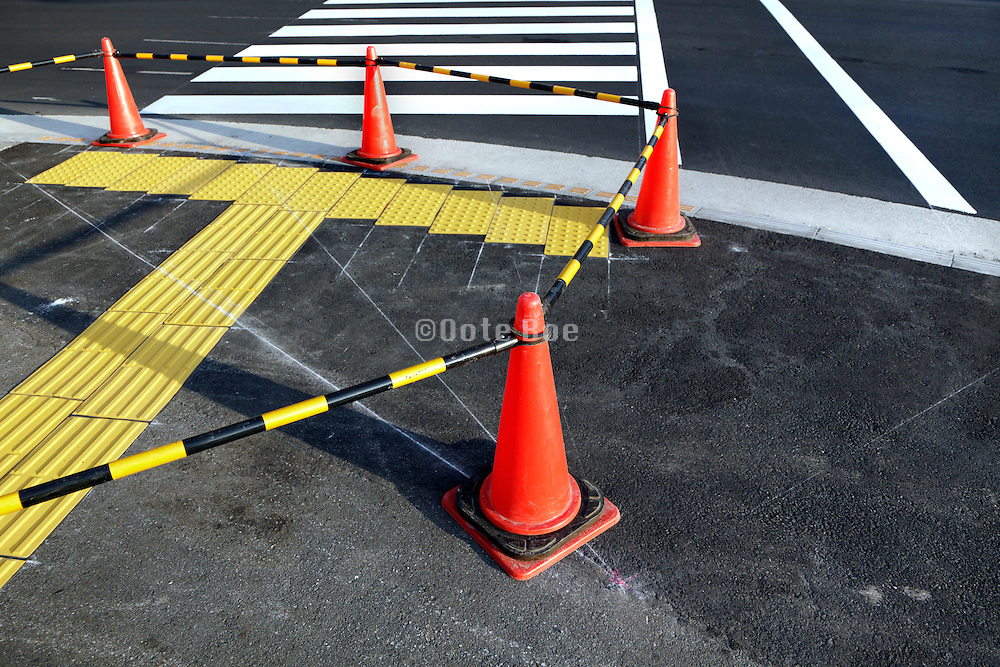street repair with for the blind tiles at a zebra crossing Japan