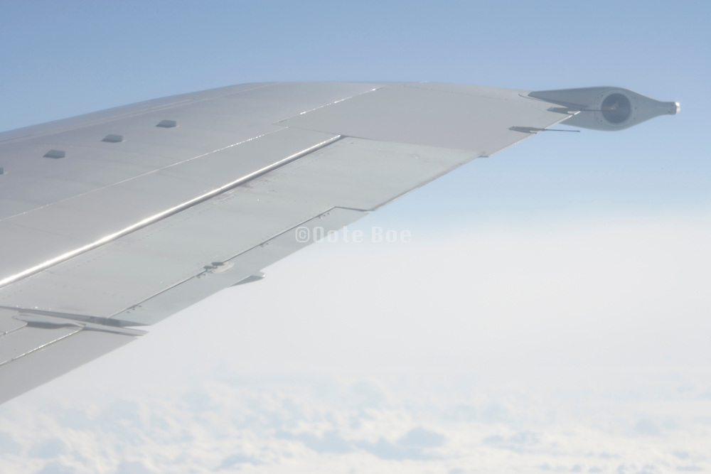 tip of the wing of an passenger airplane in mid air