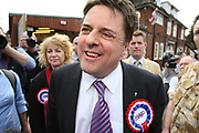 Leader of the British National Party Nick Griffin talks to reporters in the car park of a pub in the constituency of Barking and Dagenham , as his wife Jackie looks on.