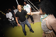 People dancing, partying, and have a good time at Lee Jones's open air Sundae dance party in 2009. This weekly event is held at the the Piazza at Schmidt's in Northern Liberties in Philadelphia each Sunday. Photos in this group are from Sundae at Octo on 9-20-09 labor day weekend and at Silk City. Music was spun by Lee Jones, Glenn Thornton, the Proper Dj & Special vocalist guest Dawn Tallman.