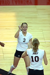 29 October 2005: Saluki Holly Marita (3) approaches Kristie Berwanger in celebration of a point won. In three games, the Illinois State Redbirds ran past the Salukis of Southern Illinois University. The matchup took place at Redbird Arena on the campus of Illinois State University in Normal IL