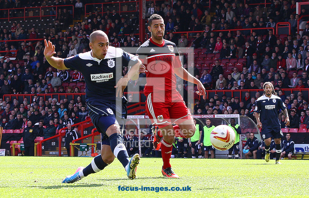 Picture by Paul Terry/Focus Images Ltd +44 7545 642257.27/04/2013.James Vaughan ( L ) of Huddersfield Town scores the opening goal during the npower Championship match at Ashton Gate, Bristol.