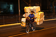Woman with her load on a bicycle, Shanghai
