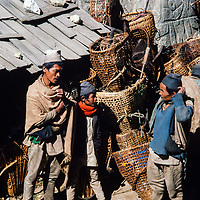 Lowland farmers relax after selling their wares at the weekly market in Namche Bazar in the Khumbu region of Nepal 1986.