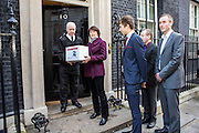The family of WWII codebreaker Alan Turing deliver Change.org petition to Downing Street signed by almost half a million people <br /> calling for more than 49,000 British gay men convicted under historic anti-gay laws in the UK. <br /> <br /> Turing's relatives Nevil Hunt (great nephew), Rachel Barnes (great niece), Thomas Barnes (great great nephew) and Matthew Todd, editor of Attitude delivered the petition to No.10 Downing Street. 23rd February 2015. <br /> Image credit must read:  © Andrew Aitchison / change.org