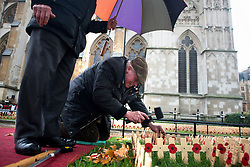 © Licensed to London News Pictures.06/11/2013. London, UK. Veteran soldiers prepare the Field of remembrance at Westminster Abbey. Every November the annual Field of Remembrance at Westminster Abbey is organised and run by The Poppy Factory. This year officially it will be opened on Thursday 7 November. Remembrance crosses are provided so that ex-Service men and women, as well as members of the public, can plant a cross in memory of their fallen comrades and loved ones.Photo credit : Peter Kollanyi/LNP