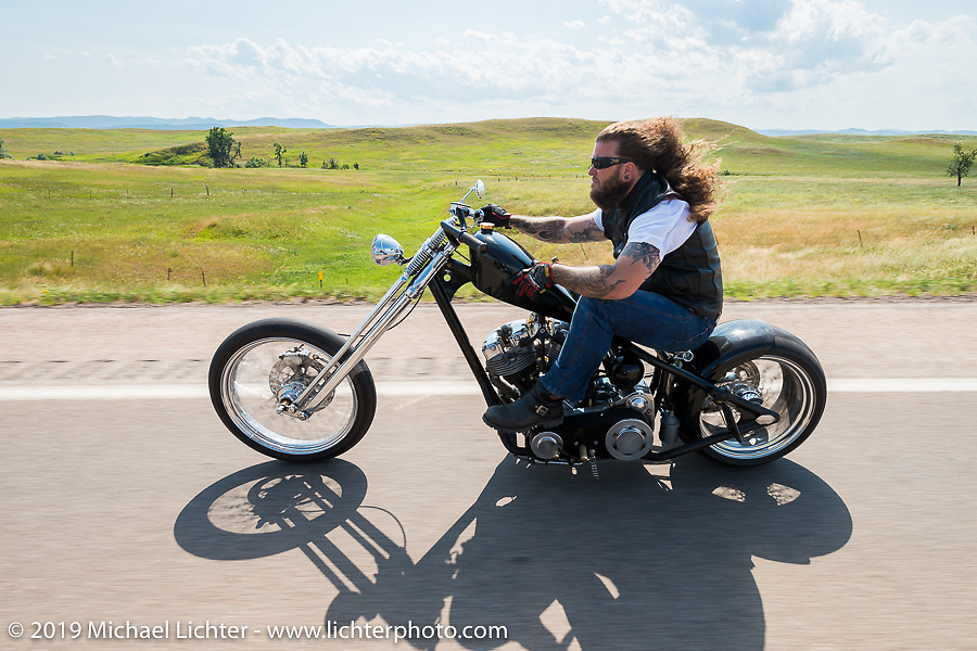 Aron Bowen of Colorado Springs, CO  riding back to Sturgis after the annual Michael Lichter - Sugar Bear Ride hosted by Jay Allen with the Easyriders Saloon during the Sturgis Black Hills Motorcycle Rally. SD, USA. Sunday, August 3, 2014. Photography ©2014 Michael Lichter.