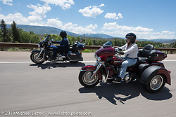 Berbon and Marlene Martin of Jasper, GA on his 2013 Ultra Limited and her 2017 Tri Glide riding from Steamboat Springs to Doc Holliday's Harley-Davidson in Glenwood Springs during the Rocky Mountain Regional HOG Rally, Colorado, USA. Thursday June 8, 2017. Photography ©2017 Michael Lichter.