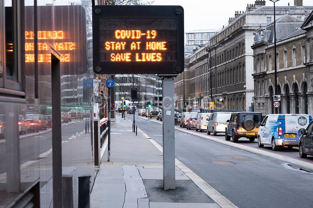 Sign for motorists on Upper Thames Street as the national coronavirus lockdown three continues on 28th January 2021 in London, United Kingdom. Following the surge in cases over the Winter including a new UK variant of Covid-19, this nationwide lockdown advises all citizens to follow the message to stay at home, protect the NHS and save lives.