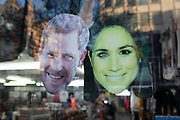 Harry and Meghan face masks in a shop window on 21st January 2020 in London, England, United Kingdom. The Meghan Markle face has gone green from being in the sun and gives a ghostly impression. Earlier it had been reported that after recent controversy and discussion amongst members of the royal family, that Prince Harry had flown out of the UK to be with his wife Meghan and their family. Prince Harry and Markle announced recently that they will step back from their roles as senior royals to share their time between the UK and Canada, and to continue both their charity work and continue to a degree their royal responsibilities.