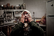 Rajah Kazah, one of the few civilians still in the town cries at her house  during a shelling by government´s tanks in Rankous, around 30km north of Damascus, Syria. January 28, 2012.  From a population of 23.000 only 60 families are still staying in a town under government troop´s siege. Photo/Tomas Munita
