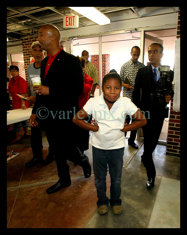 April 22nd, 2006. New Orleans, Louisiana. Voting day. Ray Nagin with his wife Seletha and daughter Tianna (7yrs) at Jesuit High School in mid city.