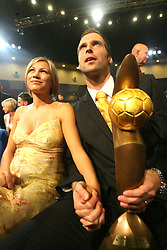 """PRAGUE, CZECH REPUBLIC - Monday, August 20, 2007: Chelsea and Czech Republic goalkeeper Petr Cech and his pregnant wife Martina. The couple announced that Martina is pregnant with their first child, due in January 2008...The couple don't yet know the sex of the child, Petr said: """"We want to know for sure as soon as possible. My guess is a girl, Martina thinks she carries a boy.""""..Petr added: """"I  want to be at the labour if mother nature allows. We kept our joy in secret and even very few people in Chelsea FC know we are expecting. But I have already bought some baby stuff during our summer camp in California. It looked like pretty small training suits! But I haven't bought any goalkeeper's gloves because I still think I shall have to purchase some dolls...(Pic by Petr Novotny/Aha!/Propaganda)"""