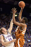 Texas forward Lamarcus Aldridge (R) puts up a shot over Kansas State's Tyler Hughes (L), during the first half at Bramlage Coliseum in Manhattan, Kansas, February 22, 2006.  The 7th ranked Longhorns held on for a 65-64 win over K-State.