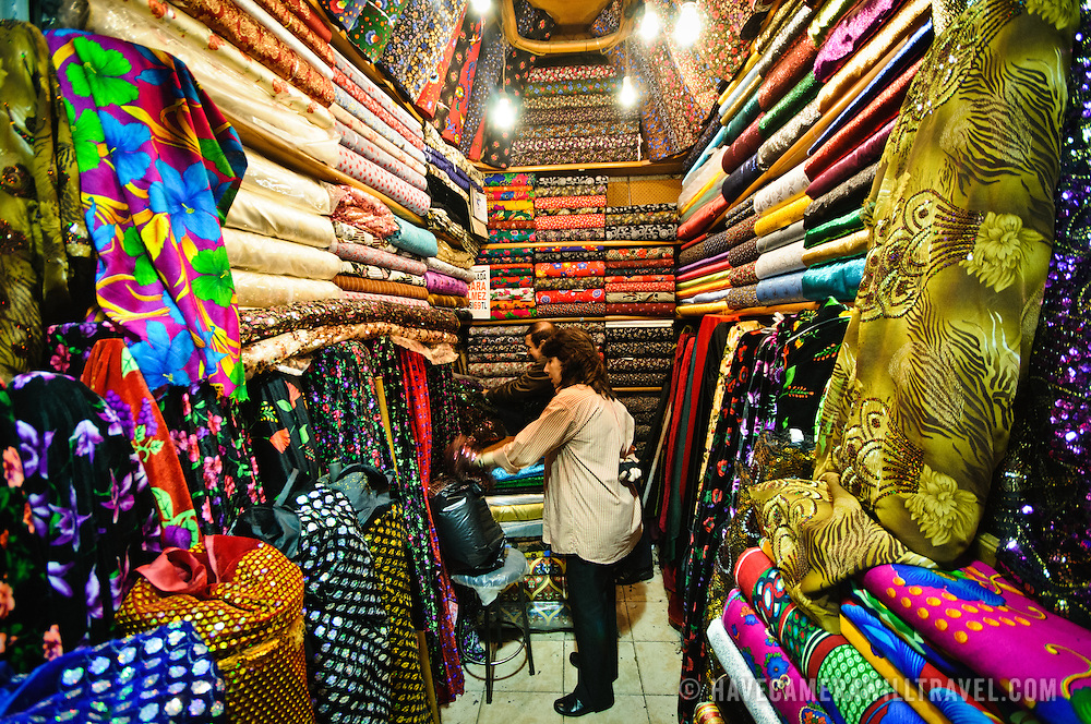 Inside a packed fabric store in Istanbul's historic Grand Bazaar. Most stores in the bazaar are not much bigger than a parking spot, so shopkeepers pack their wares to the ceiling.
