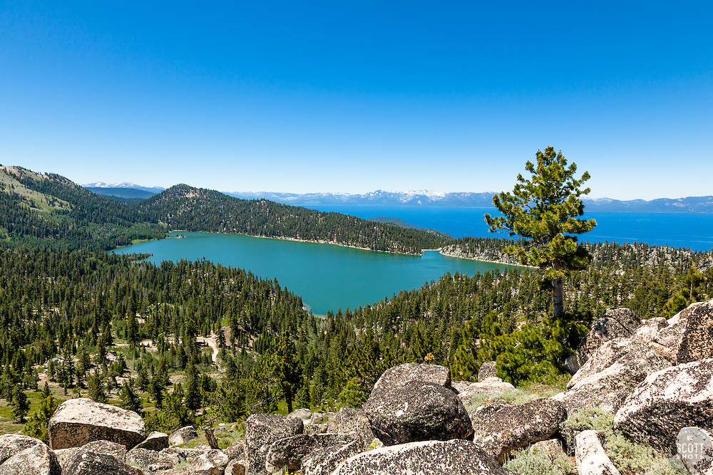 """""""Marlette Lake and Lake Tahoe 1"""" - Photograph of both Marlette Lake and Lake Tahoe with boulders in the foreground."""