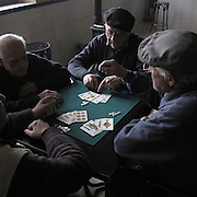 Elder men playing cards in Boadilla del Camino, Palencia province . Spain . The WAY OF SAINT JAMES or CAMINO DE SANTIAGO following the French Route, between Saint Jean Pied de Port and Santiago de Compostela in Galicia, SPAIN. Tradition says that the body and head of St. James, after his execution circa. 44 AD, was taken by boat from Jerusalem to Santiago de Compostela. The Cathedral built to keep the remains has long been regarded as important as Rome and Jerusalem in terms of Christian religious significance, a site worthy to be a pilgrimage destination for over a thousand years. In addition to people undertaking a religious pilgrimage, there are many travellers and hikers who nowadays walk the route for non-religious reasons: travel, sport, or simply the challenge of weeks of walking in a foreign land. In Spain there are many different paths to reach Santiago. The three main ones are the French, the Silver and the Coastal or Northern Way. The pilgrimage was named one of UNESCO's World Heritage Sites in 1993. When there is a Holy Compostellan Year (whenever July 25 falls on a Sunday; the next will be 2010) the Galician government's Xacobeo tourism campaign is unleashed once more. Last Compostellan year was 2004 and the number of pilgrims increased to almost 200.000 people.