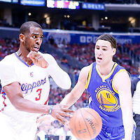 21 April 2014: Los Angeles Clippers guard Chris Paul (3) drives past Golden State Warriors guard Klay Thompson (11) during the Los Angeles Clippers 138-98 victory over the Golden State Warriors, during Game Two of the Western Conference Quarterfinals of the NBA Playoffs, at the Staples Center, Los Angeles, California, USA.
