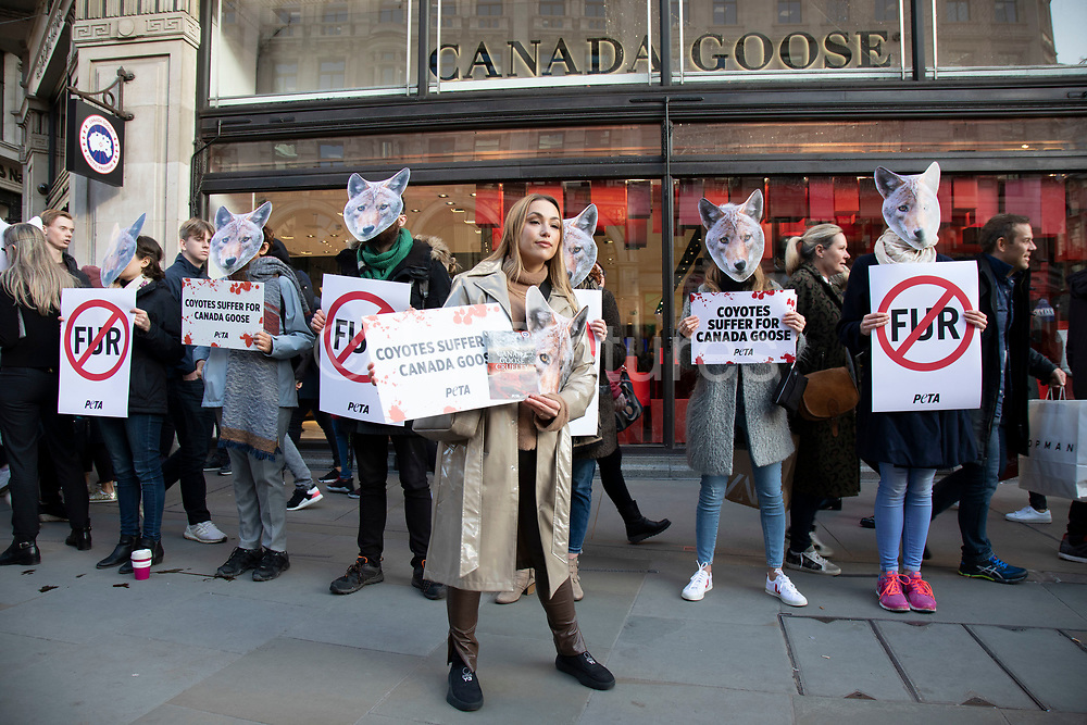 Protesters against animal cruelty wearing Coyote masks in protest outside the Canada Goose shop on Regent Street due to the fashion companys use of coyote fur in some of their products on 29th November 2019 in London, England, United Kingdom. Canada Goose is a Canadian outdoor clothing company who uses real fur as trim on the hoods of their parka coats, which is a controversial issue among animal rights groups as well as many people in the public.