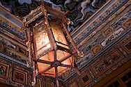 Detail of a lantern hanging from an ornate ceiling of Khai Dinh Tomb, Hue, Vietnam, Southeast Asia