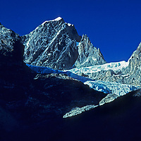 A small glacier and icefall pour off of satellite peaks to Cholatse, near Mount Everest in Nepal's Himalaya.