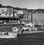 1006-C026C-10.  Newport Harbor, November 1962The Point Adams Packing Co. is at 411 SW Bay Blvd.