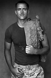 Lcpl. John Harsh, 20, Olympia, Washington, Weapons Platoon, Kilo Co., 3rd Battalion 1st Marines, 1st Marine Division, United States Marine Corps, at the company's firm base in Haditha, Iraq on Sunday Oct. 22, 2005.