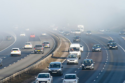 © Licensed to London News Pictures. 24/12/2018. Crockenhill, UK.M25 traffic near Swanley with some mist over motorway. Christmas eve misty sunny weather this morning as people finish up for Christmas day. Photo credit: Grant Falvey/LNP