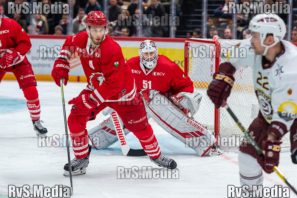 LAUSANNE, SWITZERLAND - NOVEMBER 23: #51 Goalie Tobias Stephan of Lausanne HC and #4 Petteri Lindbohm of Lausanne HC in action during the Swiss National League game between Lausanne HC and Geneve-Servette HC at Vaudoise Arena on November 23, 2019 in Lausanne, Switzerland. (Photo by Monika Majer/RvS.Media)