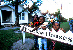 Stock photo of children posing at the Project Row sign