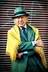 BUENOS AIRES, ARGENTINA: An Argentinian man stands on on the streets of Buenos Aires, Argentina.  .(Photo by Ami Vitale)
