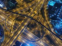 Aerial view of the illuminated Traffic line in Dubai at night, United Arab Emirates.