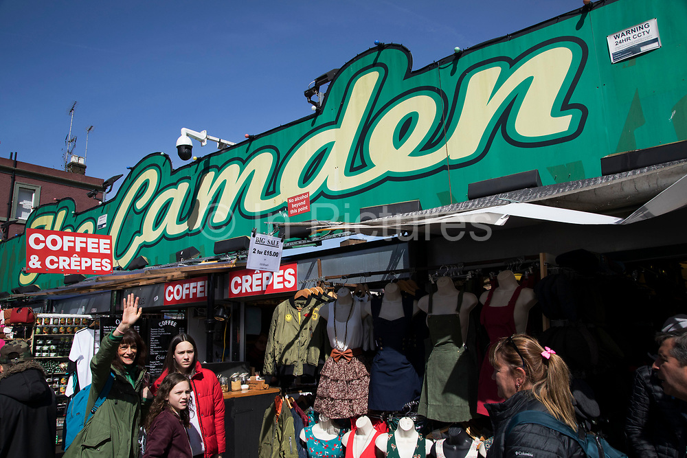 Busy hang out for young Londoners and tourists in Camden Market, London, England, United Kingdom. Camden Town is famed for its market, warren of fashion and shops near Regent's Canal, and is a haven of alternative counter culture.
