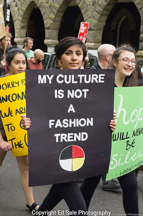 Demonstrator in 2015 May Day rally and march in Portland, Oregon shows a sign saying My Culture Is Not A Fashion Trend