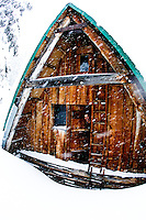Eric Lilly pokes his head out the back door (on second floor) at the hemlock butte cabin
