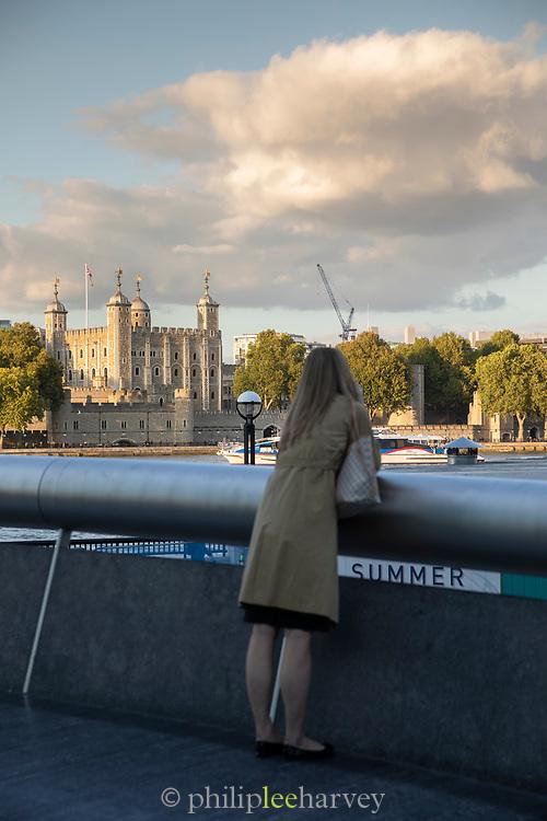 Single woman looking at Tower of London, London, England, UK