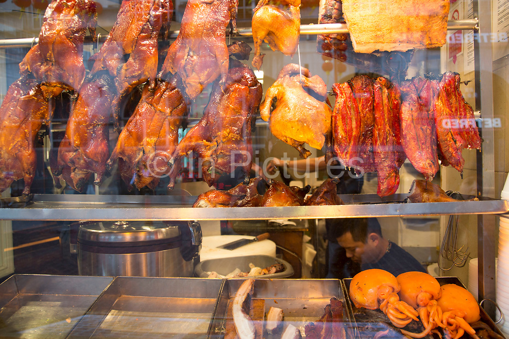 Crispy Peking Duck in a restaurant window in Chinatown in London, England, United Kingdom.