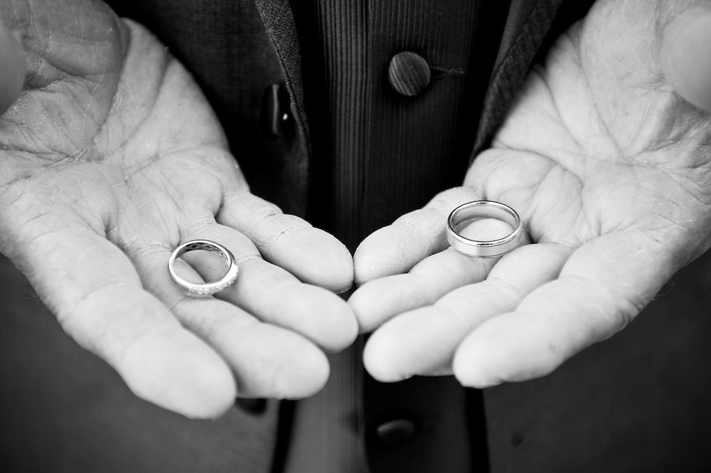 The groom's father holds the wedding rings before the wedding ceremony at the Dexter Inn, Sunapee, NH.
