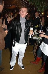 JASPER CONRAN  at a party to celebrate the publication on 'A Year in My Kitchen' by Skye Gyngell held at The Petersham Nurseries, Petesham, Surrey on 19th October 2006.<br /><br />NON EXCLUSIVE - WORLD RIGHTS