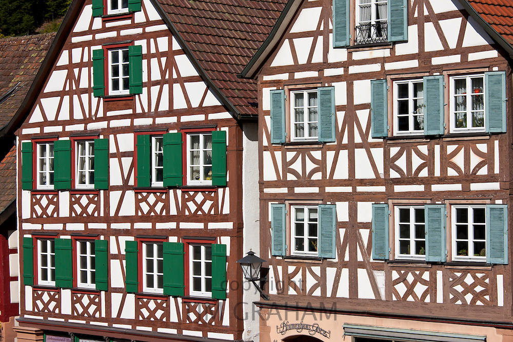 Windows and wooden shutters of traditional quaint timber-framed houses in Schiltach in the Bavarian Alps, Germany