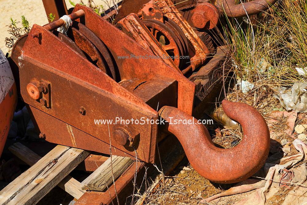 Rusty maritime hook blocks and pulleys