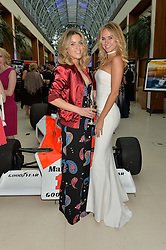 Left to right, OLIVIA COX and KIMBERLEY GARNER at the Grand Prix Ball in aid of The Prince's Trust held at The Hurlingham Club, Ranelagh Gardens, London on 6th July 2016.