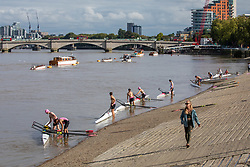 © Licensed to London News Pictures. 08/09/2020. London, UK. After the wind and rain, walkers and rowers on the Thames at Putney enjoy some warm weather as a mini heatwave for September hits the South East this week with temperatures predicted to reach up to 24c today. Photo credit: Alex Lentati/LNP