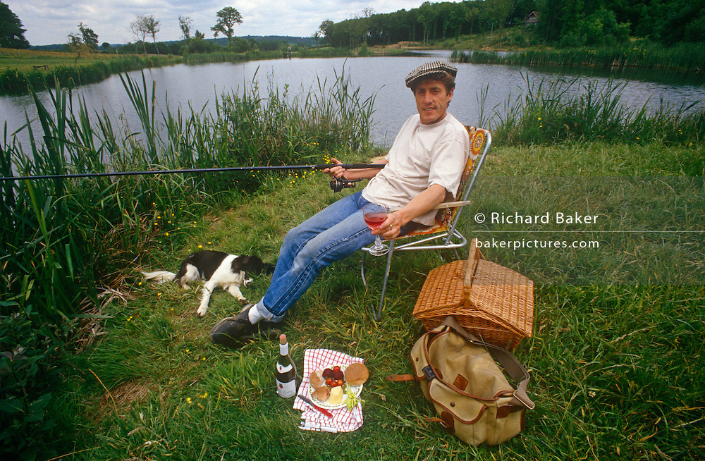 A portrait of English singer and musician, Roger Daltrey relaxing at the water's edge at the trout farm he developed, in the summer of 1989, near Burwash, England. Roger Harry Daltrey, CBE (b1944) is an English singer-songwriter and actor. In a career spanning more than 50 years, Daltrey came to prominence in the mid-1960s as the founder and lead singer of the English rock band The Who, which released fourteen singles that entered the Top 10 charts in the United Kingdom during the 1960s, 1970s, and 1980s.