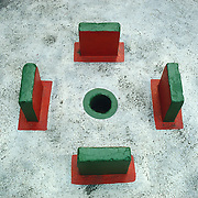 Traditional structure with painted stones and hole